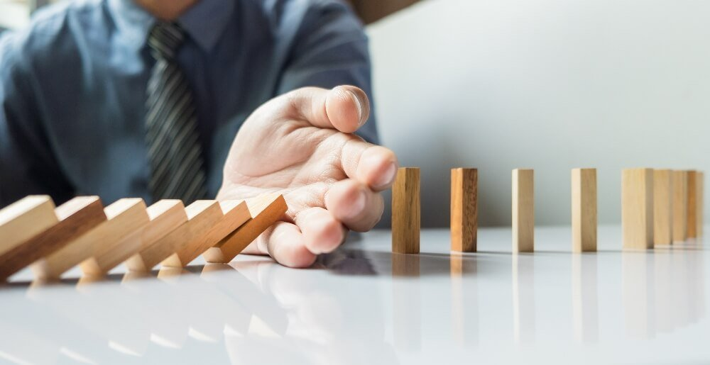 businessman hand stop dominoes continuous toppled or risk